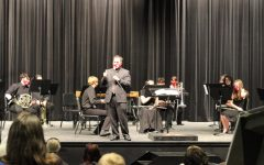 Director of bands, Justin Elks introduces the concert band. This concert marked the first of Elks career as the new director.