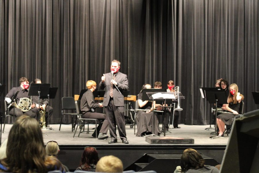 Director of bands, Justin Elks introduces the concert band. This concert marked the first of Elks' career as the new director.